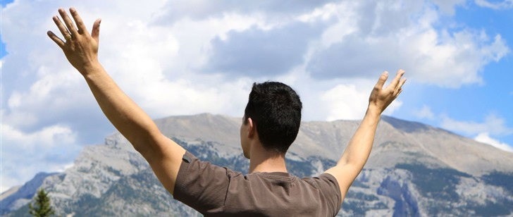 Prayer-Man-with-lifted-hands-in-front-of-mountain_thumb